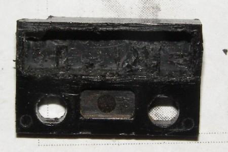 Фотография очищенного от заливки и геркона корпуса датчика